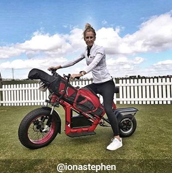 Woman on Red Finn Electric Golf Scooter